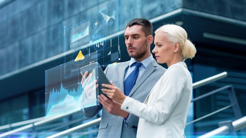 business man and woman looking at tech data