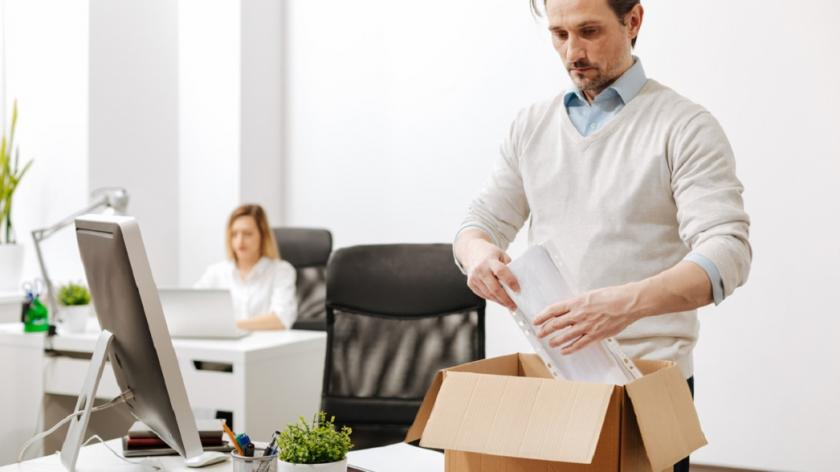 employee packs a box at his desk