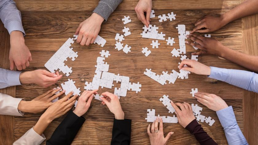 People putting puzzle pieces together