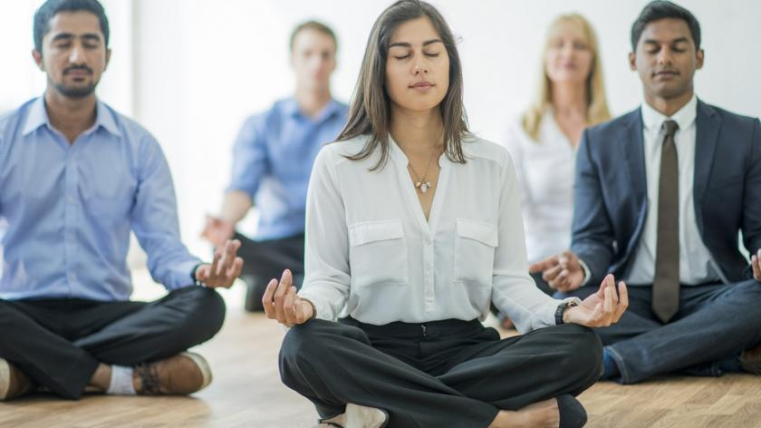 business people meditating