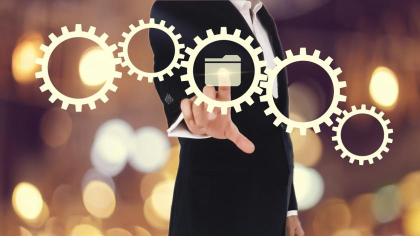 business man pointing at digital gears