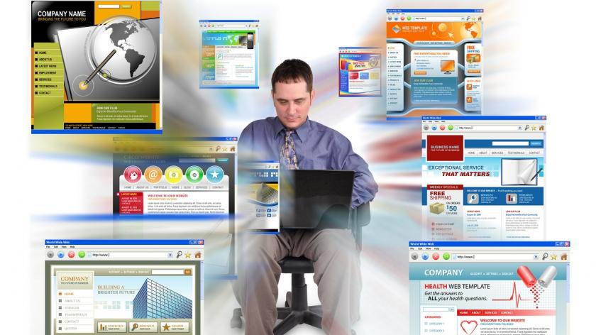 man with laptop and website images