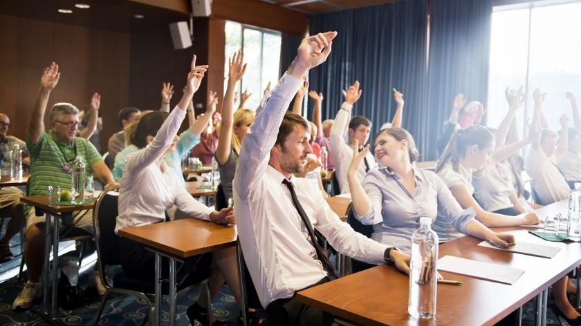 raised hands in a business lecture