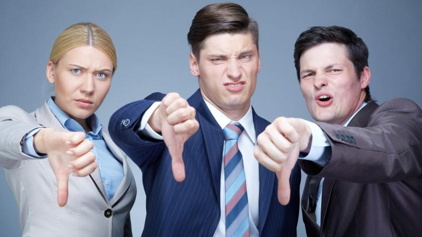 business people give thumbs down