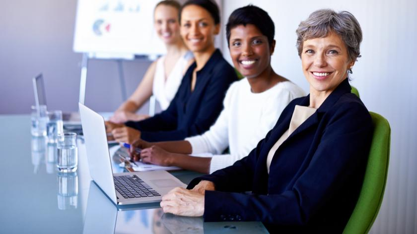 professional women at a meeting table