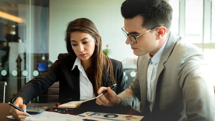 Young accountant with client